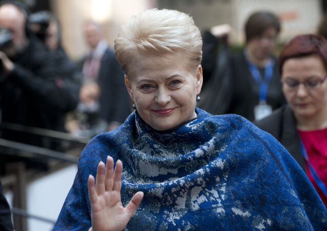 Lithuanian President Dalia Grybauskaite waves as she arrives for an EU summit in Brussels on Thursday, March 17, 2016.