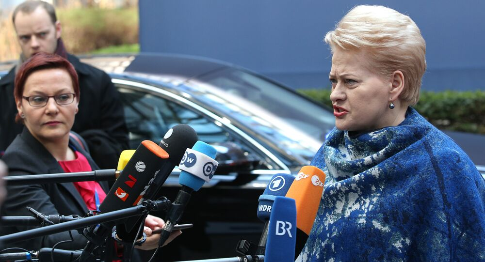 Lithuanian President Dalia Grybauskaite speaks with the media as she arrives for an EU summit at the EU Council building in Brussels on Thursday, March 17, 2016.
