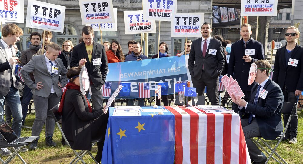 Activists stage mock talks as they demonstrate against the Transatlantic Trade and Investment Partnership (TTIP) between the EU and the USA outside the European Parliament at Luxembourg Place in Brussels on February 24, 2016.