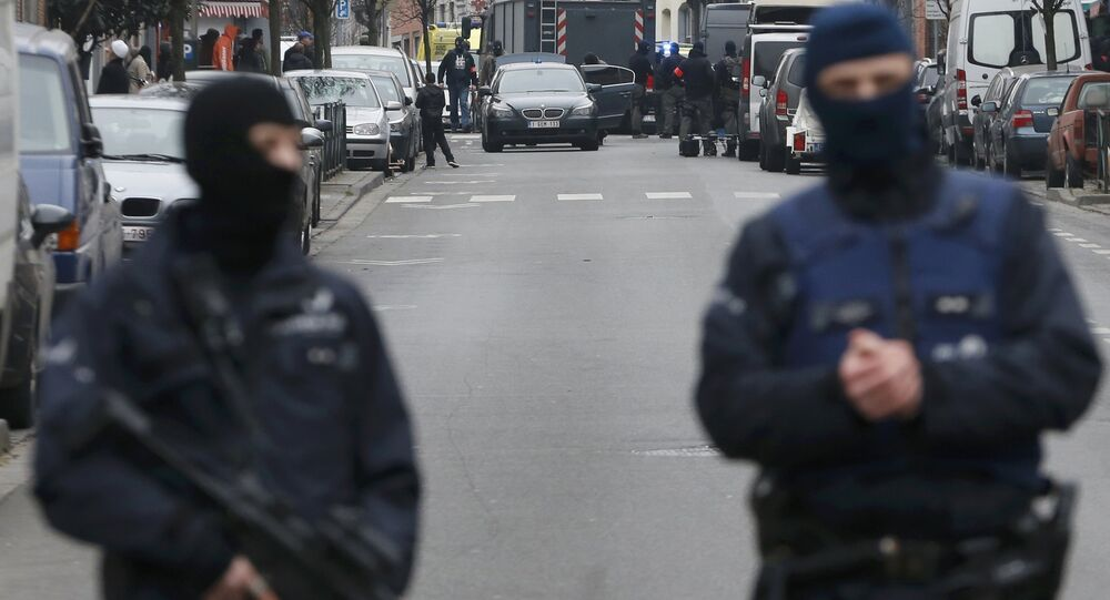 Police at the scene of a security operation in the Brussels suburb of Molenbeek in Brussels, Belgium