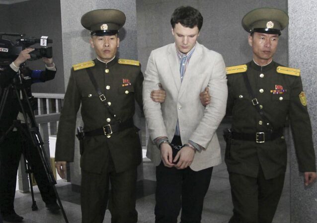 American student Otto Warmbier, center, is escorted at the Supreme Court in Pyongyang.
