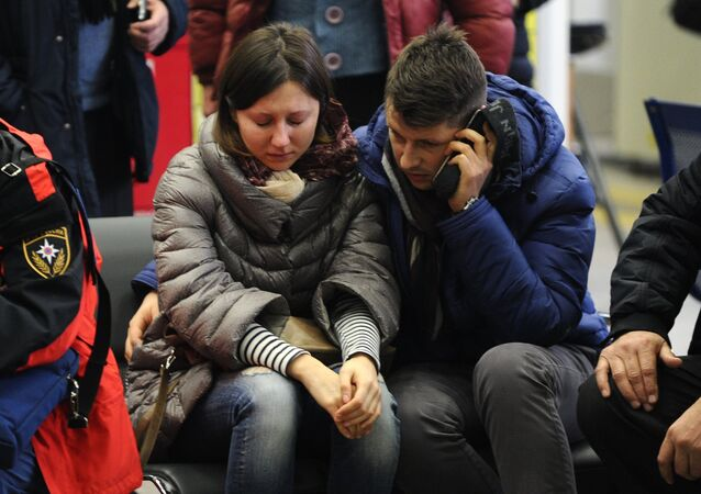 Relatives of a victim of the crashed Flydubai Boeing 737-800 at the airport of Rostov-On-Don, Russia