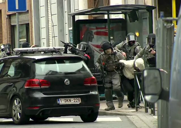 Armed Belgian police apprehend a suspect, in this still image taken from video, in Molenbeek, near Brussels, Belgium, March 18, 2016. Belgian-born Salah Abdeslam, one of the main suspects from November's Paris attacks, was arrested after a shootout with police in Brussels on Friday, the Belgian federal prosecutor's office said.
