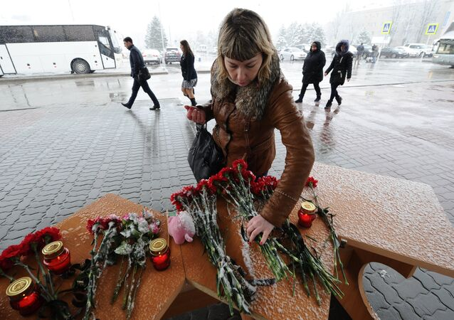A woman lays flowers at Rostov-on-Don airport where the Boeing-737-800 passenger jet crashed on landing.