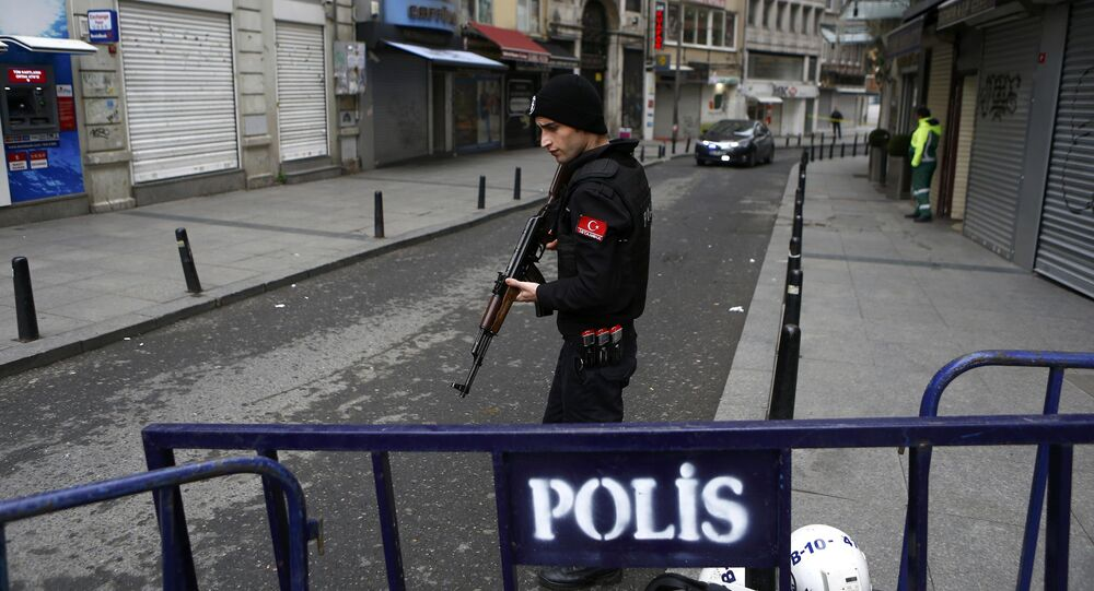A police officer secures the area following a suicide bombing in a major shopping and tourist district in central Istanbul March 19, 2016.