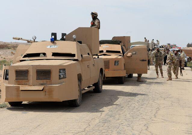 The Desert Falcons self-defense unit re-deploy outside Palmyra, Syria.