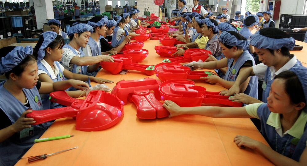 Workers assemble toy cars in Dongguan, China. (File)