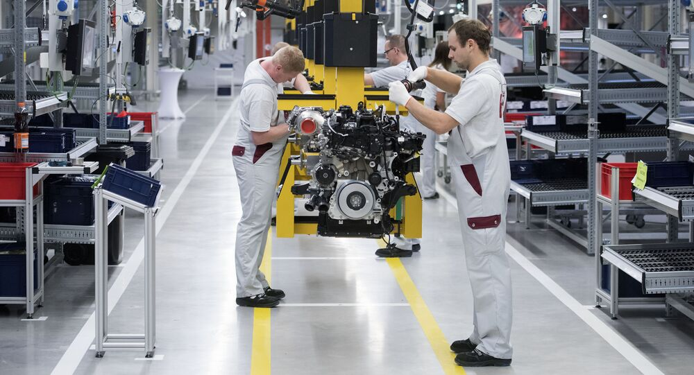 Workers complete the new four-cylinder diesel engine OM 654 during the official start of production in the MDC Power GmbH, a company of the German Daimler AG, in Koelleda, central Germany