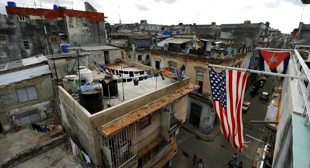 US and Cuban flags are seen on a balcony in Havana, Cuba March 19, 2016.