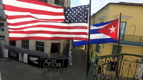 US and Cuban flags are seen on the balcony of a restaurant in downtown Havana, Cuba March 19, 2016. - Sputnik International