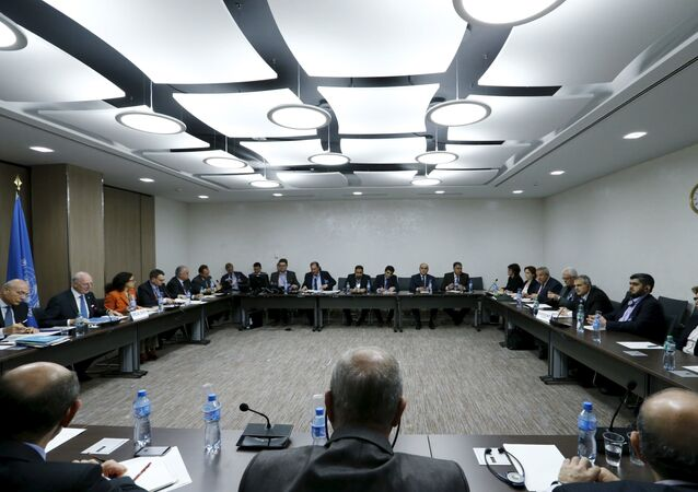 The delegation of the High Negotiations Committee (HNC) and U.N. mediator Staffan de Mistura are seen at the start of a meeting during Syria peace talks at the United Nations in Geneva, Switzerland, in this March 17, 2016 file photo