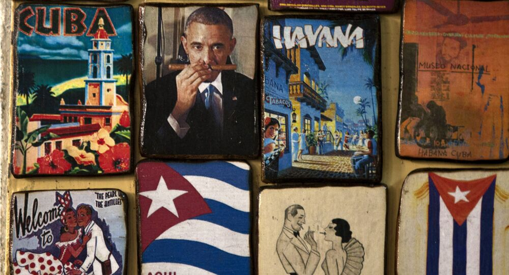 Magnets for sale decorate a tourist shop, one showing an image of U.S. President Barack Obama smelling a cigar, at a market in Havana, Cuba, Monday, March 16, 2015