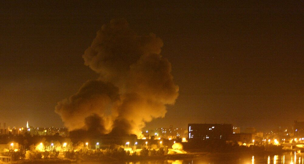 Fire and smoke can be seen over Baghdad Thursday night, March 27, 2003