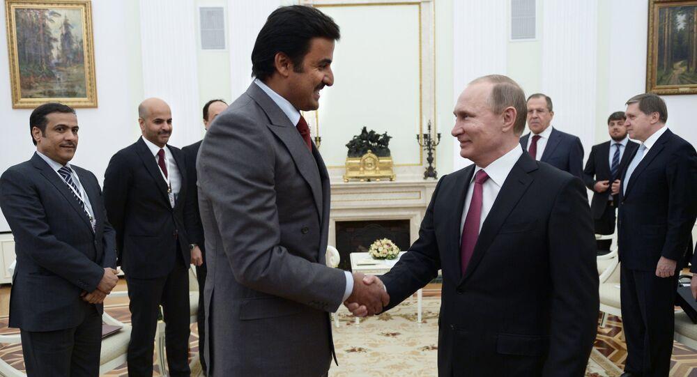 President Vladimir Putin meets with Qatar Emir Tamim bin Hamad Al-Thani. File photo