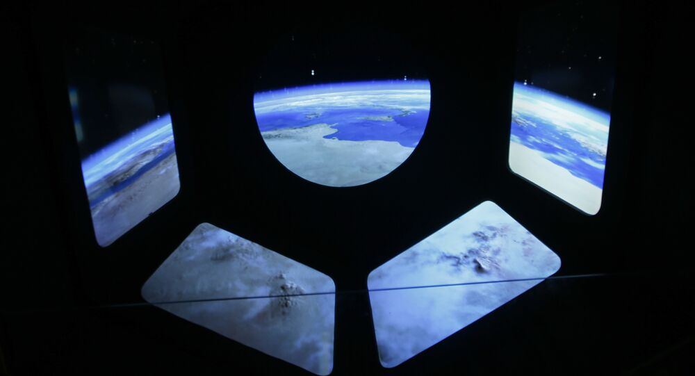 Once completed, the ground elements will eventually be supplemented by a trio of high-orbit satellites that will actually detect gravitational waves.  Above: A reproduction of the view of the earth from a spaceship.