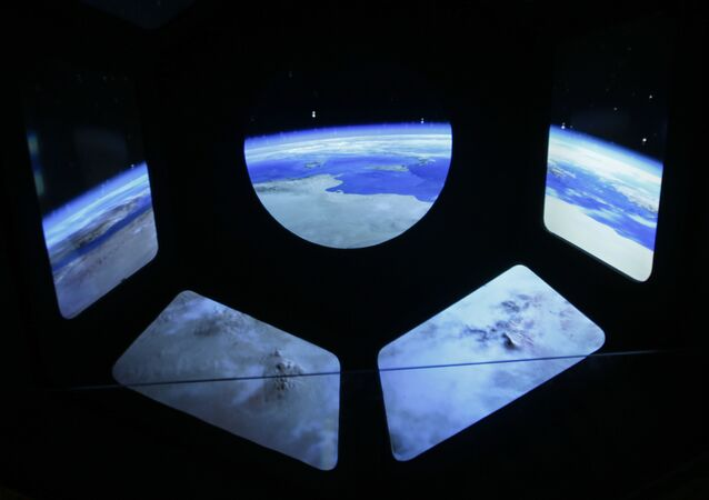A reproduction of the view of the earth from a spaceship is displayed at the museum of the science and technologies in Milan, Italy, Friday, Feb. 12, 2016