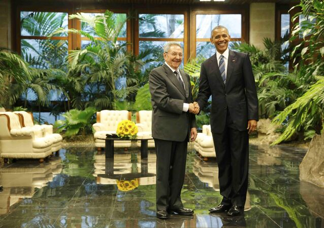U.S. President Barack Obama and Cuba's President Raul Castro shake hands during their first meeting on the second day of Obama's visit to Cuba, in Havana March 21, 2016