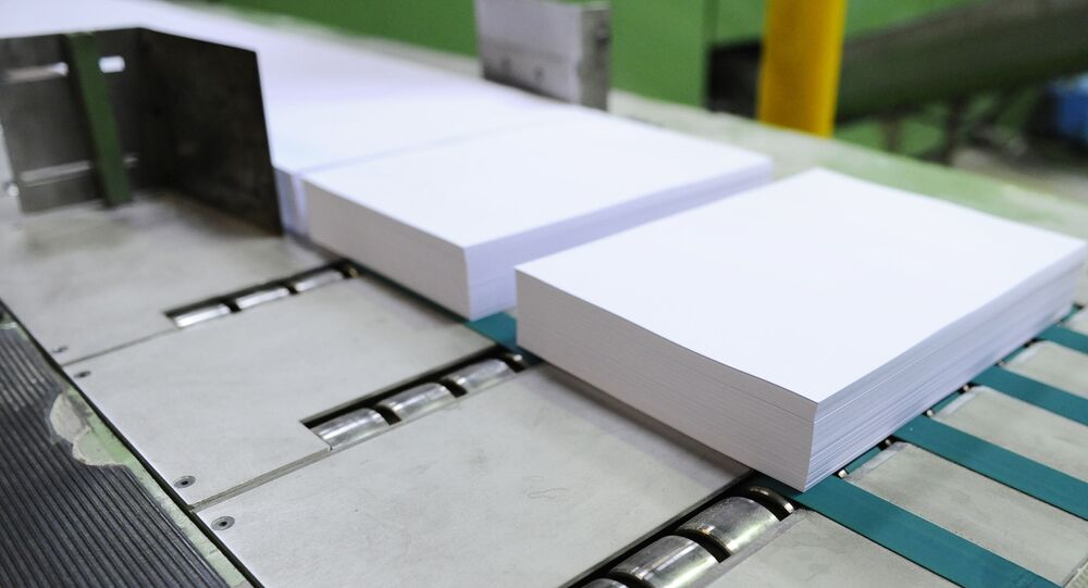 Paper being manufactured on a production line