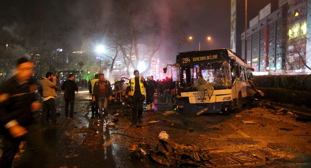 Emergency workers work at the explosion site in Ankara, Turkey March 13, 2016