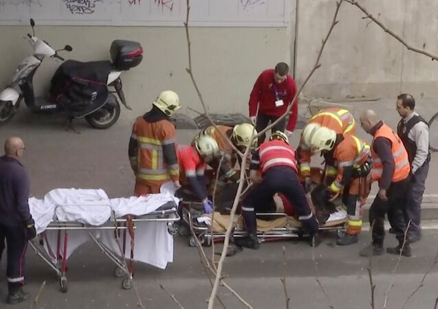 In this image made from video, emergency rescue workers stretcher an unidentified person at the site of an explosion at a metro station in Brussels, Belgium, March 22, 2016
