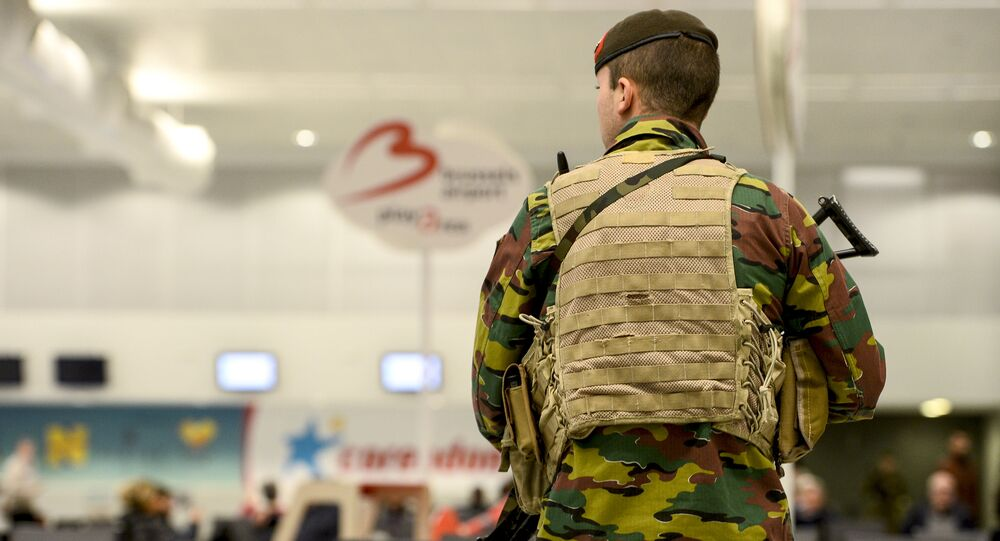 A military police soldier patrols the Brussels Airport
