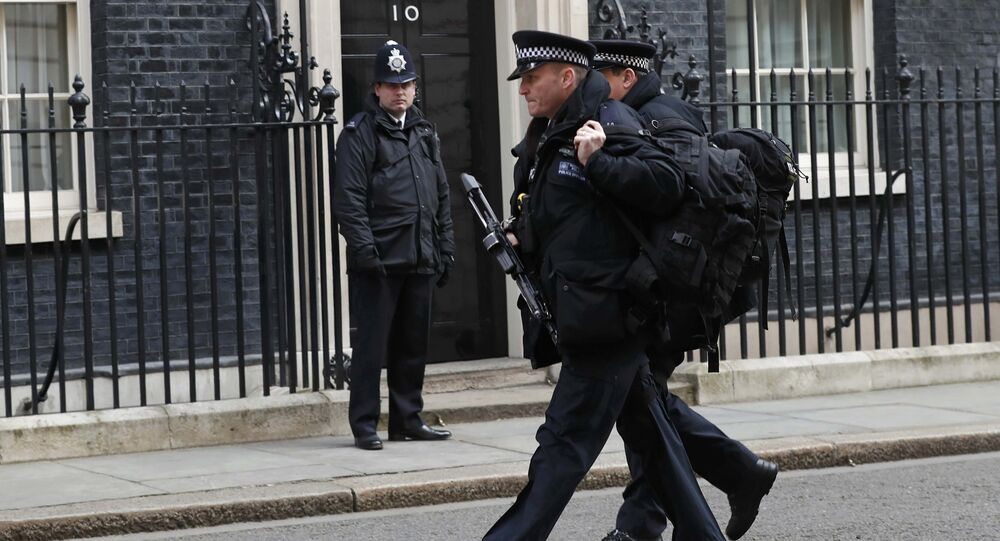 Armed police walk along Downing Street in London, Britain March 22, 2016