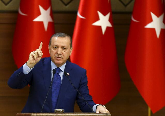 Turkish President Tayyip Erdogan makes a speech during his meeting with mukhtars at the Presidential Palace in Ankara, Turkey, March 16, 2016