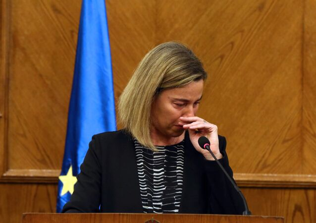 EU foreign policy chief Federica Mogherini reacts during a joint press conference with Jordanian Foreign Minister in the capital Amman, on March 22, 2016, upon receiving the news about a string of explosions that rocked Brussels airport and a city metro station