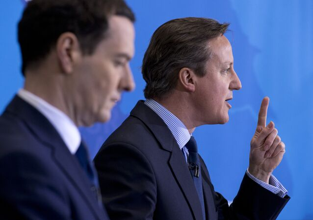 British Prime Minister and leader of the Conservative Party, David Cameron (R), speaks next to Conservative Chancellor of the Exchequer George Osborne (L) on April 20, 2015.