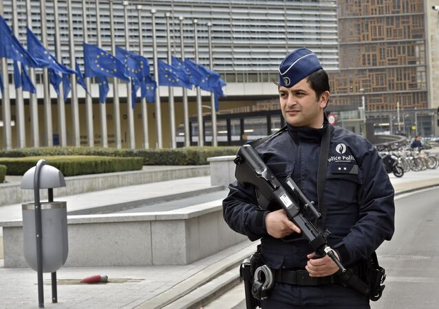 Police patrol the EU commission building, after a bomb exploded nearby, at the subway in Brussels, Belgium, Tuesday, March 22, 2016