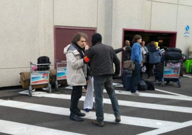 People are seen at the scene of explosions at Zaventem airport near Brussels, Belgium, March 22, 2016