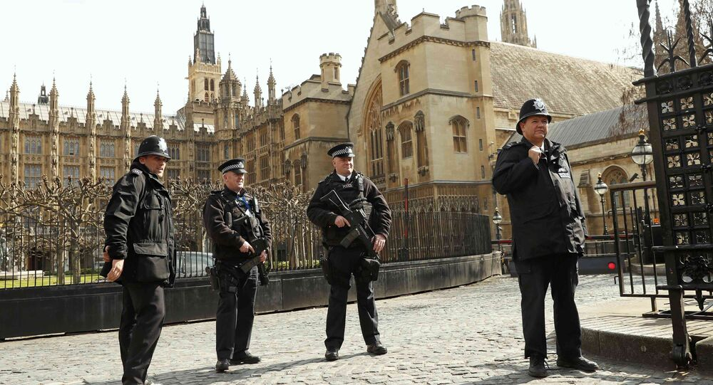 Armed police stand on guard at the Houses of Parliament in London, Britain March 22, 2016. Britain's Prime Minister David Cameron said he would chair a crisis response meeting following explosions in Brussels on Tuesday