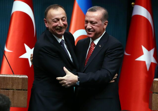 Azerbaijani President Ilham Aliyev (L) and Turkish President Recep Tayyip Erdogan (R) huging after signing bilateral agreements following the 5th Turkey-Azerbaijan High Level Strategic Cooperation Council meeting at the Presidential Complex in Ankara