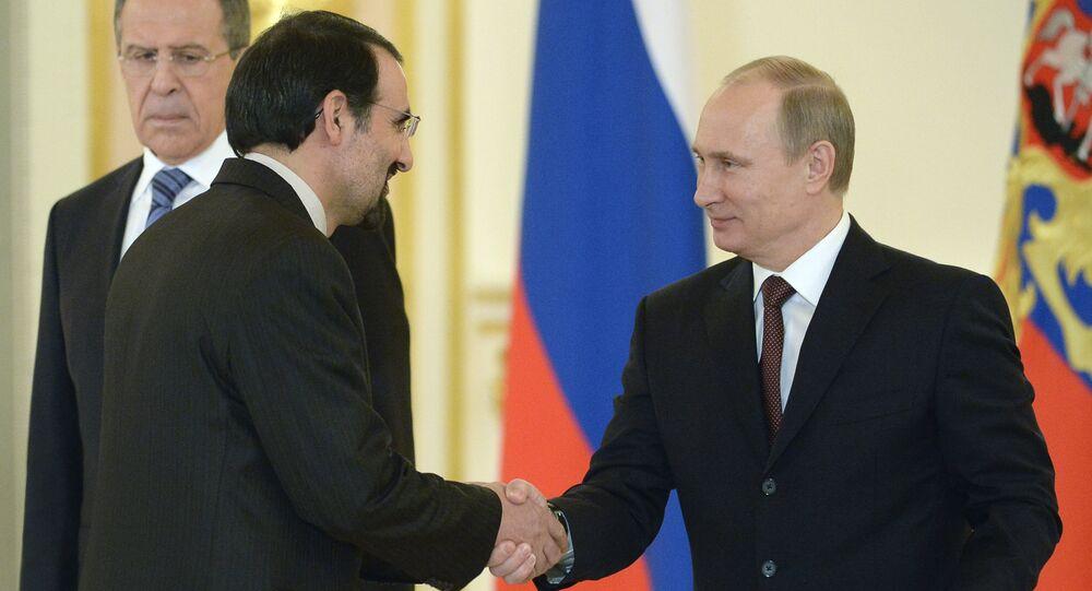 Russia's President Vladimir Putin (R) shakes hands with Iran's ambassador to Russia, Mehdi Sanai (File)