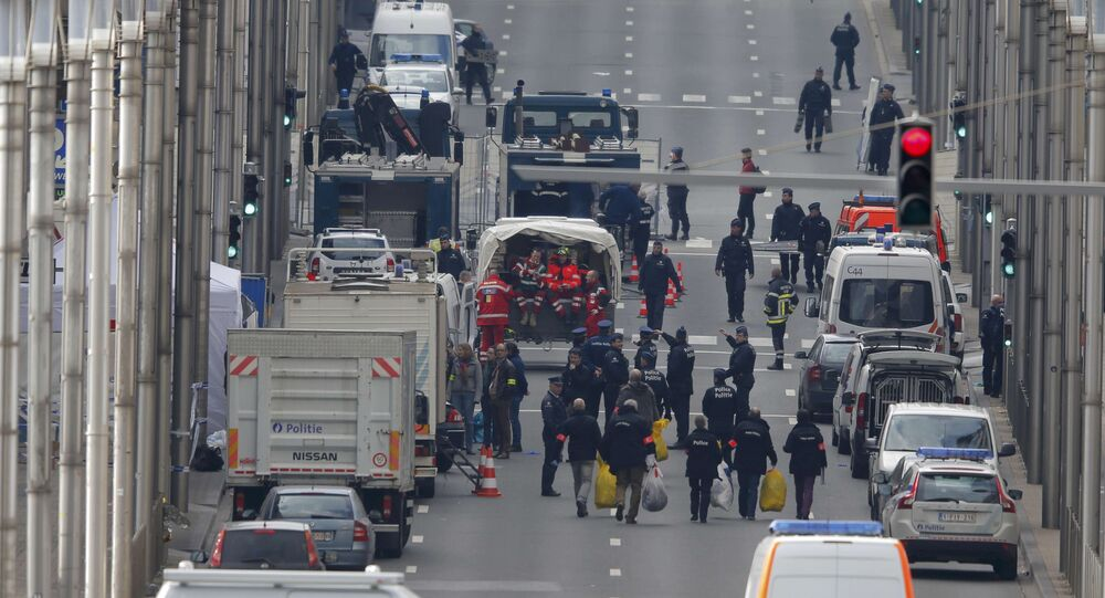 Belgian police and emergency personnel work near the Maalbeek metro station following an explosion in Brussels, Belgium, March 22, 2016