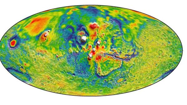A Martian gravity map showing the Tharsis volcanoes and surrounding flexure. The white areas in the center are higher-gravity regions produced by the massive Tharsis volcanoes, and the surrounding blue areas are lower-gravity regions that may be cracks in the crust (lithosphere). - Sputnik International