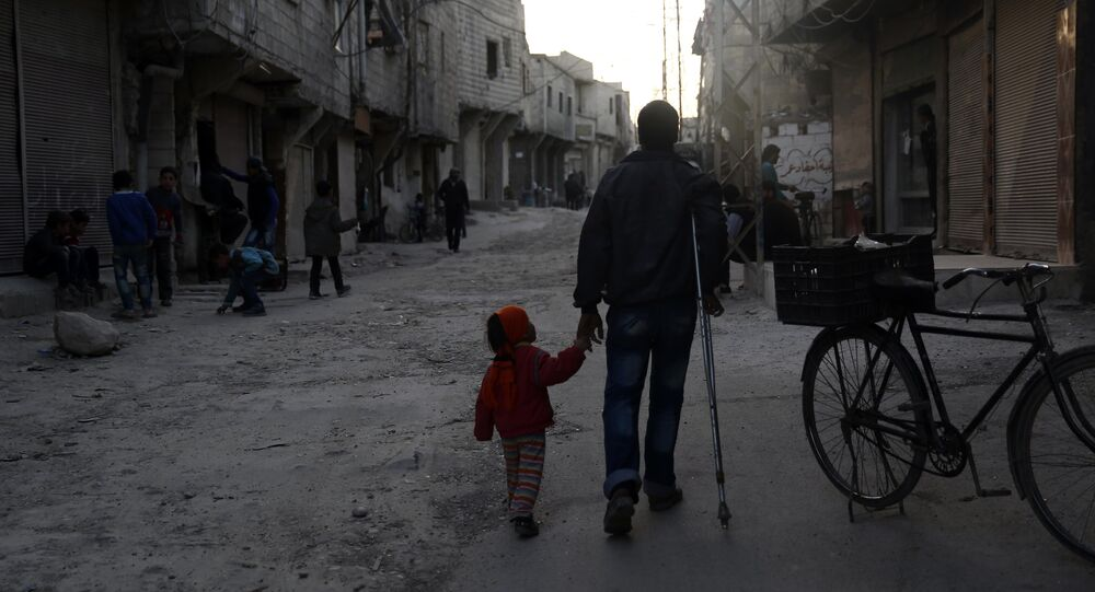An injured Syrian man walks holding his daughter's hand in Barza, a northern suburb of the capital Damascus, on March 22, 2016