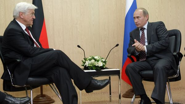 Prime Minister Vladimir Putin talks with Frank-Walter Steinmeier (File) - Sputnik International