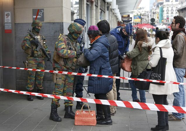 Belgian troops search people entering a subway station following Tuesday's bomb attacks in Brussels, Belgium, March 23, 2016