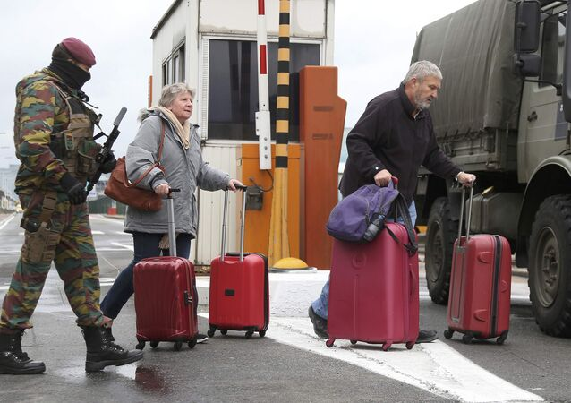 A Belgian soldier accompanies passengers at Brussels' Zaventem airport following Tuesday's bomb attacks in Brussels, Belgium, March 23, 2016.