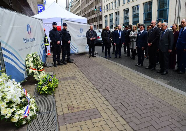 French Prime Minister Manuel Valls (C), Belgian Prime Minister Charles Michel (front 2nd-R) and European Commission President Jean-Claude Juncker (front R) pay their respects after laying wreaths at the Maelbeek - Maalbeek subway station entrance in Brussels on March 23, 2016, a day after blasts his the Belgian capital