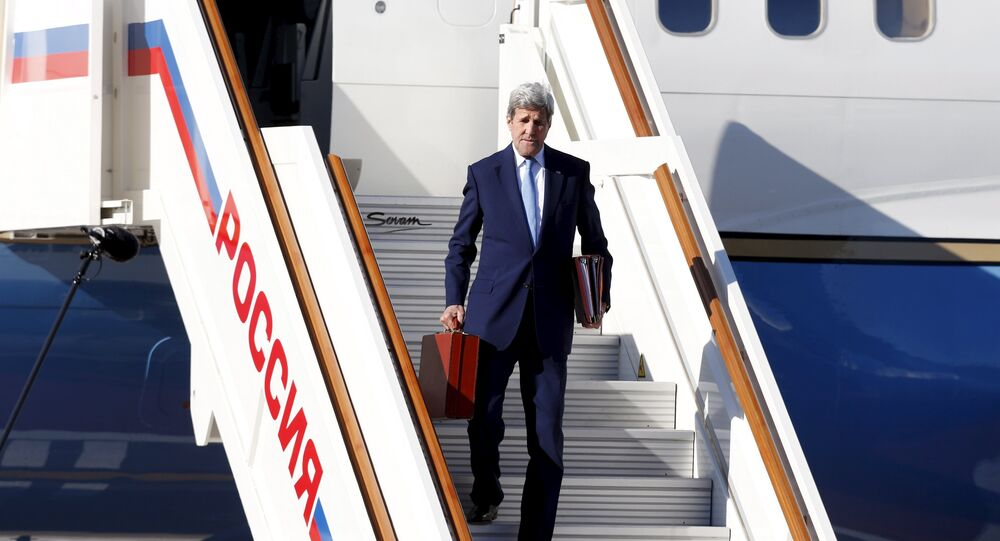 U.S. Secretary of State John Kerry gets off a plane upon his arrival at Moscow's Vnukovo airport, Russia, March 23, 2016