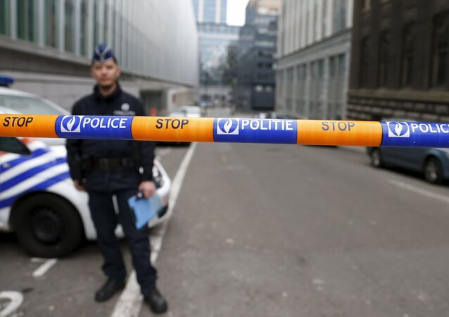A Belgian police officer stands guard near the federal police headquarters in Brussels, March 19, 2016, after Salah Abdeslam, the most-wanted fugitive from November's Paris attacks, was arrested after a shootout with police in Brussels on Friday.