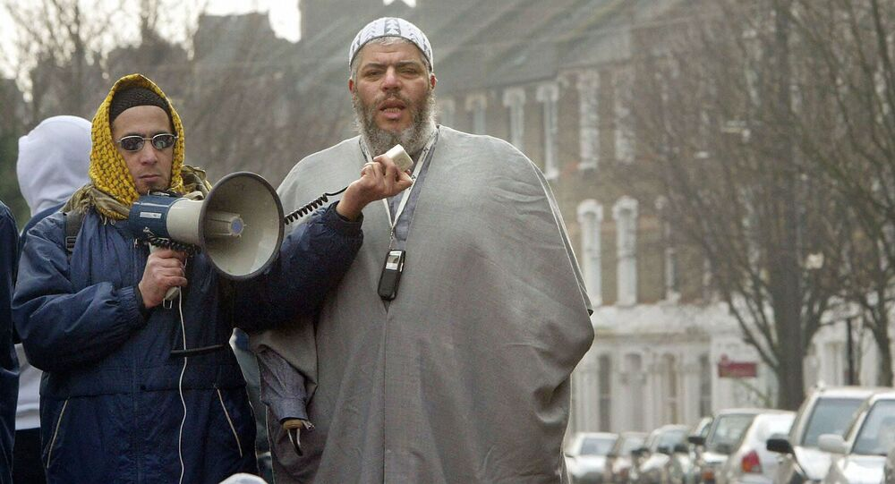 This file picture shows radical Imam Abu-Hamza al Masri leading prayers outside the closed Finsbury Park Mosque. UK (File)