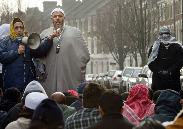 This file picture shows radical Imam Abu-Hamza al Masri leading prayers outside the closed Finsbury Park Mosque.