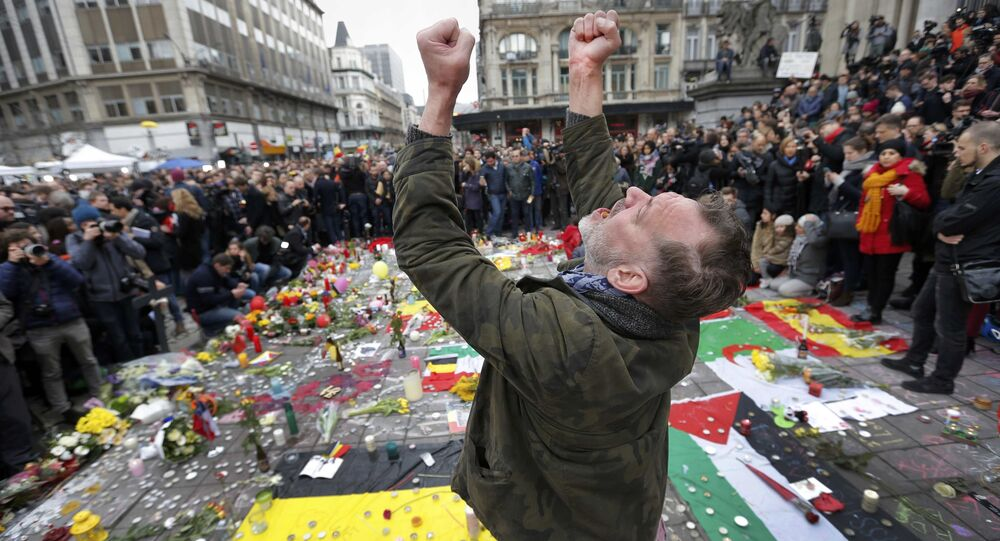 A man reacts at a street memorial following Tuesday's bomb attacks in Brussels, Belgium, March 23, 2016
