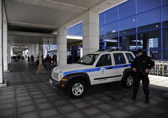 A police officer stands outside the Athens Eleftherios Venizelos International Airport near Athens, Greece, March 22, 2016