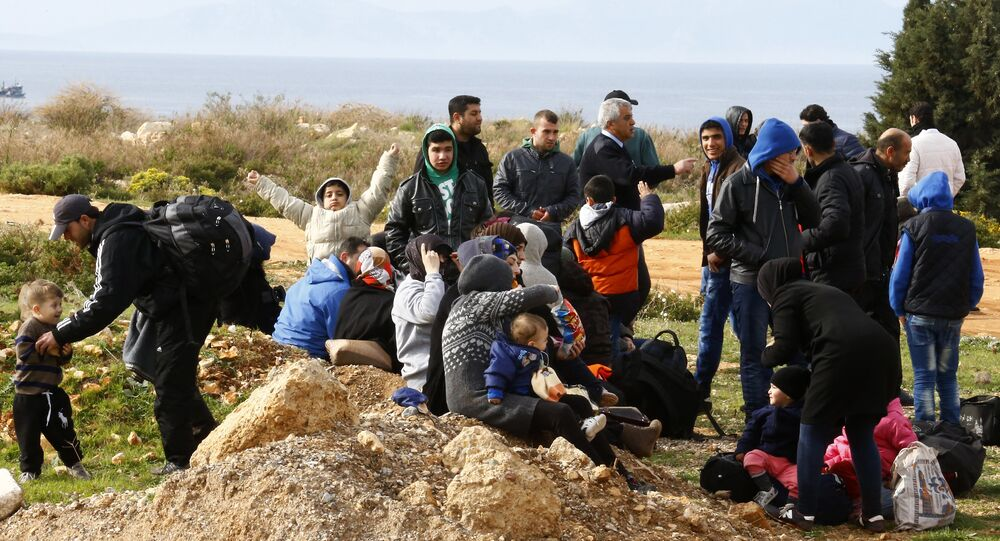 Refugees wait on a roadside after Turkish police prevented them from sailing off to the Greek island of Farmakonisi by dinghies, near a beach in the western Turkish coastal town of Didim, Turkey, March 9, 2016