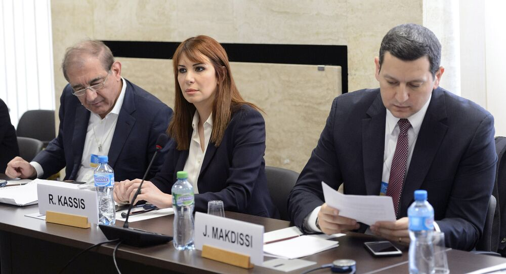 Syria's former deputy Prime Minister Qadri Jamil (L), Randa Kassis (C) and Jihad Makdissi, members of Syria's opposition react before a round of negotiations between Syria's opposition and the U.N., at the European headquarters of the United Nations in Geneva, Switzerland, March 23, 2016