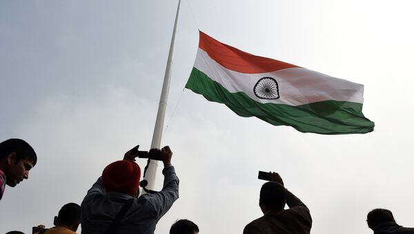 Indian residents photograph India's tallest flag as it is unveiled in Faridabad on the outskirts of New Delhi on March 3, 2015 - Sputnik International